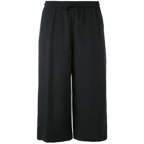 Imagen principal de producto de Nike pantalones capri de estilo holgado - Negro - Nike