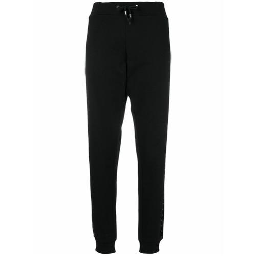 Imagen principal de producto de Versace Jeans pantalones joggers con ribete de apliques - Negro - Versace