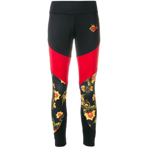Imagen principal de producto de Nike floral print track pants - Negro - Nike