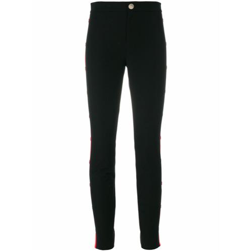 Imagen principal de producto de Gucci pantalones pitillos con panel lateral con botones Web - Negro - Gucci