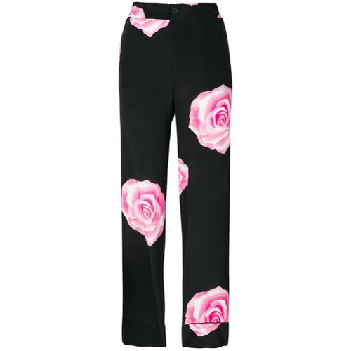 Imagen principal de producto de Ganni pantalones con estampado de rosas - Negro - Ganni