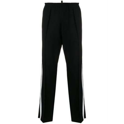 Calça de alfaiataria com contraste preta em algodão, Dsquared2. Possui cós elástico, fechamento por zíper, detalhe de li...
