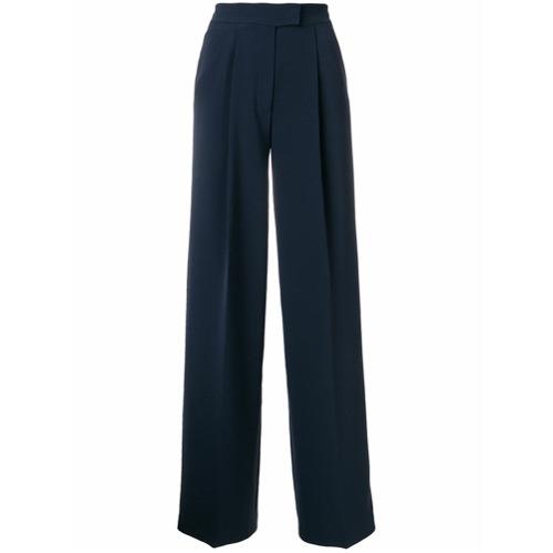 Calça de alfaiataria azul marinho, Tommy Hilfiger. Possui fechamento oculto, detalhe de pregas, detalhe de vincos e mode...
