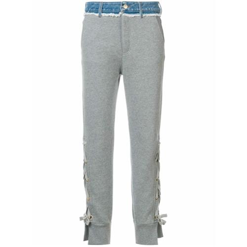 Calça esportiva cinza em algodão, Tommy Hilfiger. Possui corte de alfaiataria e passantes para cinto.