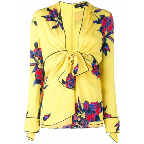 Blusa com estampa floral amarela em seda, Proenza Schouler. Possui decote em U com debrum, fechamento por laço, mangas l...