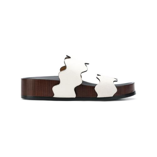 Sandália de couro 'Lauren' com plataforma branca, Chloé. Possui abertura nos dedos, detalhes ondulados, solado com logo...