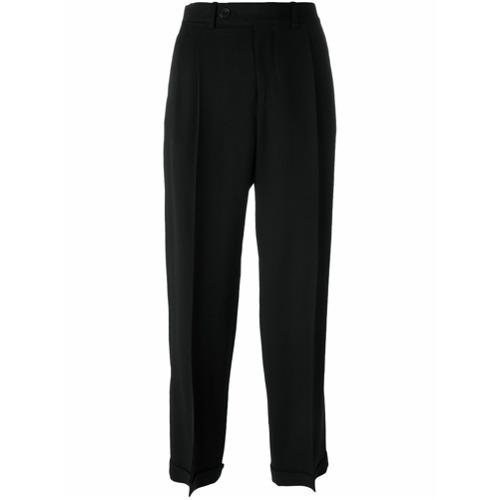 Calça de alfaiataria cropped preta em lã mista , Maison Margiela. Possui cintura alta, fechamento por botão e zíper, pas...