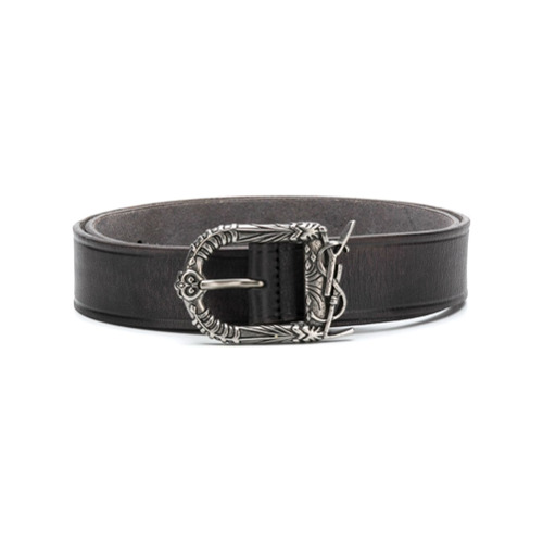 Saint Laurent references Western style with this embossed buckle belt, crafted in Italy and featuring a leather strap, a...
