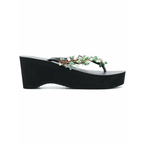 Black wedge flip flops with embellished straps from Uzurii.
